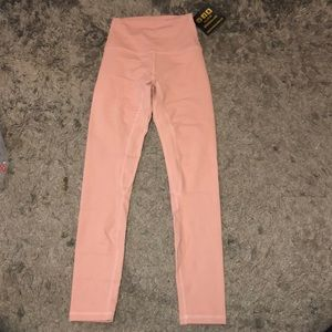 Salmon colored high waisted leggings